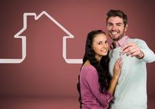 Соедините держать ключевой с значком дома перед виньеткой Стоковое Изображение RF