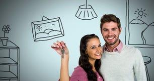 Соедините держать ключевой с чертежами дома дома перед виньеткой Стоковые Изображения