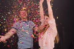 Соедините дуя confetti в воздухе изолированном над серым цветом Стоковая Фотография RF