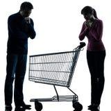 Соедините человека женщины унылого с пустым силуэтом магазинной тележкаи Стоковые Фото