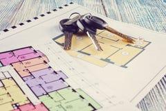 Соединять новый ключ на плане проекта многоквартирного дома Стоковые Фото