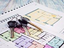 Соединять новый ключ на плане проекта многоквартирного дома Стоковые Фотографии RF
