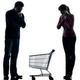 Соедините человека женщины унылого с пустым силуэтом магазинной тележкаи Стоковая Фотография