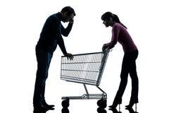 Соедините человека женщины унылого с пустым силуэтом магазинной тележкаи Стоковое Изображение RF