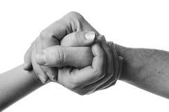 Соедините человека и женщины держа руки на белой предпосылке Стоковая Фотография