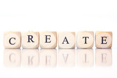 Создайтесь, сказанный по буквам с письмами кости Стоковая Фотография RF