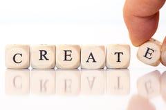 Создайтесь, сказанный по буквам с письмами кости Стоковые Фотографии RF