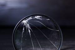 Сокрушанный путем ударять УЛЬТРАФИОЛЕТОВЫЙ фильтр для объектива фото Стоковое Фото