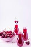 Сок вишни в бутылках Стоковая Фотография