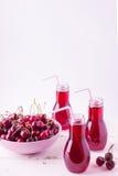 Сок вишни в бутылках Стоковое Изображение