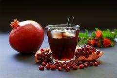 Сок гранатового дерева, плодоовощ, семена, ветви Стоковая Фотография