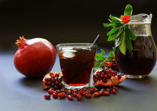 Сок гранатового дерева, плодоовощ, семена, ветви Стоковые Изображения