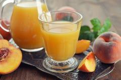 Сок персика Стоковые Фото