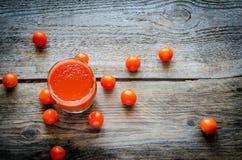 Сок томата с томатами вишни Стоковое фото RF