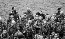 Солдаты после сражения с черно-белым Стоковые Изображения