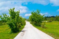 солнечное дороги дня сельское Стоковая Фотография RF