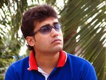 солнечные очки человека молодые стоковое фото