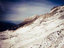 Солнечный на горном виде снега Стоковое Изображение