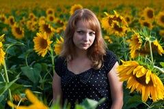 солнцецветы девушки Стоковые Фотографии RF