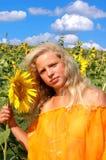 солнцецветы девушки Стоковое Изображение
