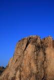 солнце загоранное скалой отвесное Стоковые Изображения