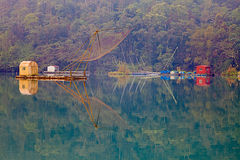 солнце луны озера рыболовства традиционное Стоковое Фото