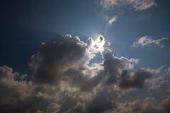 солнце облака пряча Стоковое фото RF