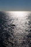 солнце отражения океана шлюпки Стоковая Фотография RF