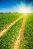солнце проселочной дороги к Стоковые Изображения RF