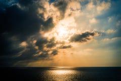 Солнце установило на море Стоковое Изображение