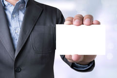 Сообщение бизнесмена на показанной карточке Стоковая Фотография