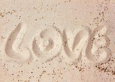Сообщение влюбленности в песке стоковое фото rf