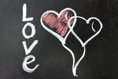 Сообщение влюбленности Надпись на классн классном с мелом стоковые фото