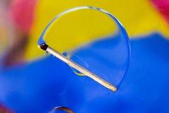 Соответствуйте в красочной предпосылке падений воды и масла Стоковое Изображение RF