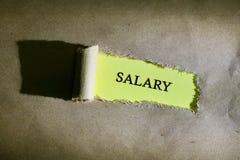 Сорванная бумага с зарплатой слова стоковое изображение