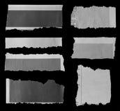 Сорванные бумаги на черноте Стоковые Изображения RF
