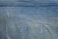 Сорванные старые голубые джинсы Стоковые Фото