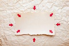 сорванный красный цвет части стрелок бумажный Стоковые Фото