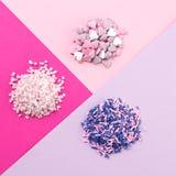 Сортированная конфета брызгает кучи стоковые фото
