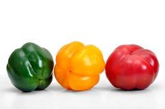 Сортированные свежие пестротканые перцы на белой предпосылке Стоковые Изображения