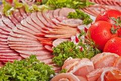 Сосиска вырезывания и вылеченное мясо с петрушкой Стоковое Фото