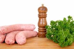 сосиска свинины вырезывания доски говядины Стоковая Фотография