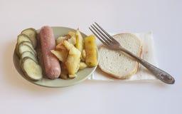 Сосиска с картошками Стоковое Изображение