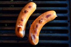 Сосиски на гриле барбекю стоковое изображение