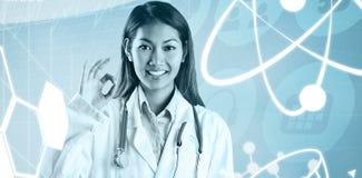 Составное изображение азиатского доктора делая одобренный знак Стоковая Фотография RF