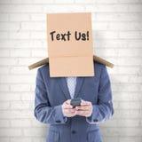Составное изображение анонимного бизнесмена используя телефон Стоковые Фотографии RF