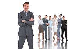 Составное изображение бизнесмена в сером костюме усмехаясь на камере Стоковое Изображение