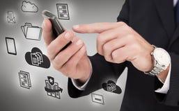 Составное изображение бизнесмена в стеклах используя его ПК таблетки Стоковое Изображение RF