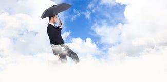 Составное изображение бизнесмена держа портфель под зонтиком Стоковые Изображения
