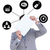 Составное изображение бизнесмена держа пустой знак перед его головой Стоковое Фото